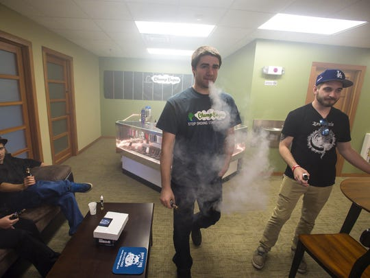 Chris Gelinas, manager at Champ Vapes in Burlington, center, in the store's vape lounge on Monday, May 9, 2016.