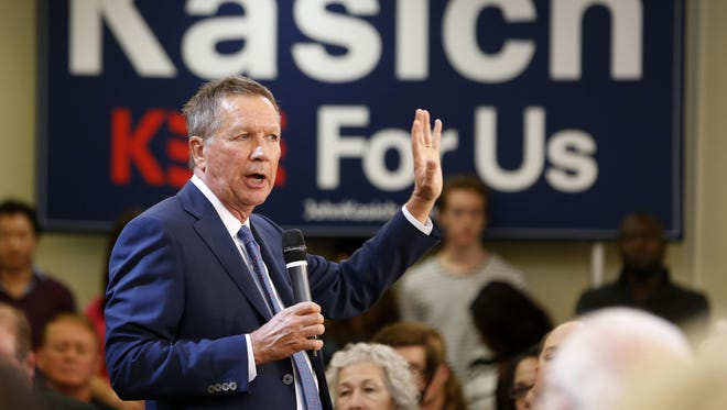 Republican presidential candidate, Ohio Gov. John Kasich gestures during a town hall meeting at the University of Richmond in Richmond, Va., Monday.
