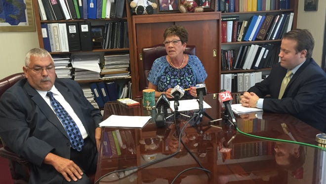 From left, Social Services Commissioner Art Johnson, Broome County Executive Debbie Preston and Public Health Director Sean Britton discuss the opioid crisis Friday during a news conference.