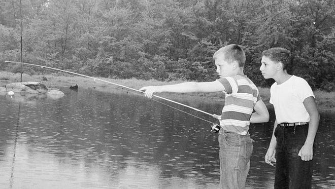 Walter Johnson and Carl Nencetti, then aged 13, point to where they found the body of William X. Harth in Levy's Pond, Suffern, in August, 1960.