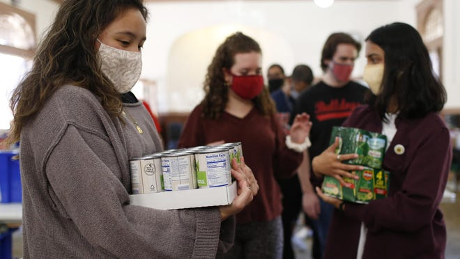 University of Georgia students sort food donations before packing Thanksgiving meals for UGA's Campus Kitchen and the Athens Community Council on Aging on Nov. 20.