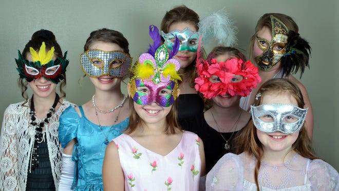 Students take part in the Nevada Junior Cotillion's 2014 spring masquerade at St. Thomas Aquinas Cathedral's Righini Hall in Reno.