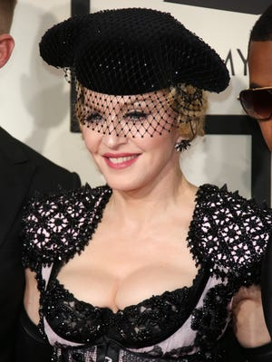 Madonna arrives at the 57th annual Grammy Awards at the Staples Center in Los Angeles, CA.