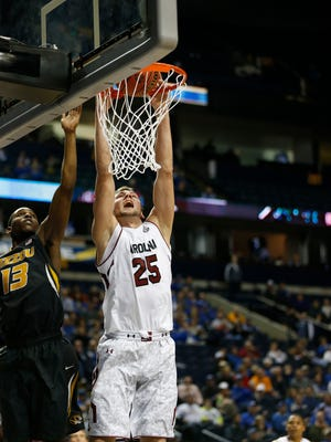 South Carolina forward Mindaugas Kacinas (25) shoots against Missouri guard Montaque Gill-Caesar (13) during the second half of an NCAA college basketball game in the first round of the Southeastern Conference tournament, Wednesday, March 11, 2015, in Nashville, Tenn.