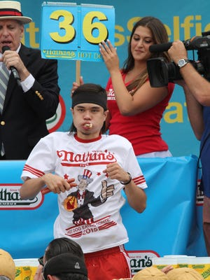 Matt Stonie competes in Nathan's Famous Fourth of July International Hot Dog Eating Contest men's competition Saturday in the Coney Island section of the Brooklyn borough of New York. Stonie won the competition, eating 62 hot dogs and buns in 10 minutes.