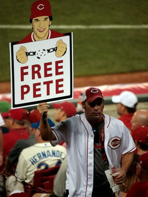 A fan holds a sign for Pete Rose during the 2015 MLB All-Star Game at Great American Ball Park.