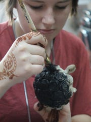 Sheradia Linton works on a turtle art project.