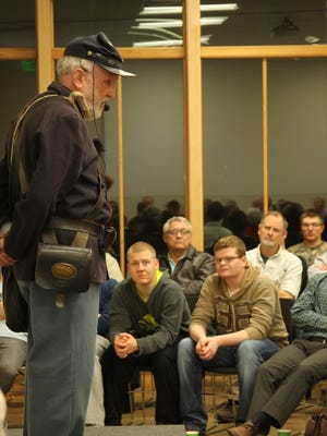 """The audience listens to O.J. Fargo, who portrayed Union soldier Thomas Goodfellow from Afton, Iowa, during his presentation of """"Just Before the Battle, Mother - A Visit from a Civil War Soldier"""" at Drake Community Library on Tuesday, Feb. 23."""