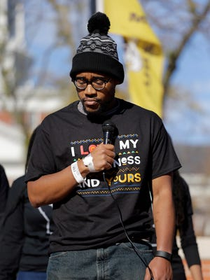 Jonathan Butler, the Mizzou student body president who went on a hunger strike to protest systemic campus racism, addresses a crowd Nov. 9, 2015, after the announcement that University of Missouri System President Tim Wolfe would resign.