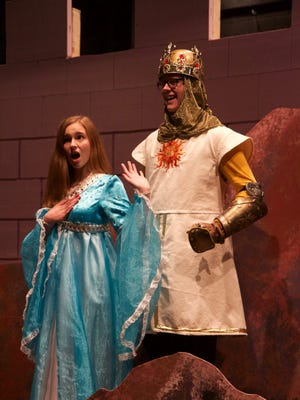 "Neenah High School juniors McKenna Seekers (left), playing Lady of the Lake and Spencer Pier, in the role of King Arthur, rehearse for the opening of ""Spamalot"" on Thursday at Pickard Auditorium."