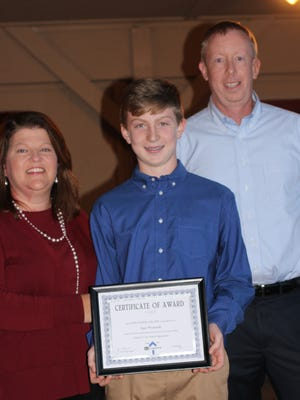 Sam Womack, recipient of the Friends to the Rescue UpStander Award, with his parents Tammy and Mike Womack.
