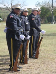 Carlsbad Veterans Honor Guard stand during the Veterans