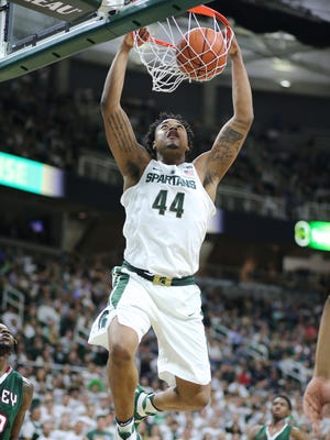 Michigan State's Nick Ward dunks during MSU's 100-53 win Friday at Breslin Center.