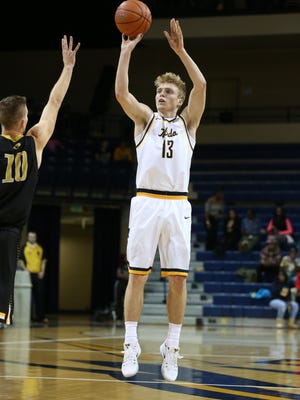 Toledo sophomore Jaelan Sanford attempts a 3-pointer earlier this season. The Reitz High School graduate is averaging 12.3 points for the Rockets.