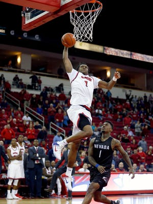 Fresno State guard Jaron Hopkins prepares to dunk the ball in front of Nevada's Marcus Marshall for the go-ahead score with 33 seconds left.