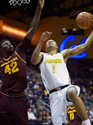 California's Ivan Rabb (1) drives to the hoop past Arizona State's Jethro Tshisumpa (42) during the first half of an NCAA college basketball game Sunday, Jan. 1, 2017, in Berkeley, Calif. (AP Photo/D. Ross Cameron)