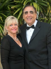 CEO of the Y, Cindy Love, is seen with her husband George Abounader.