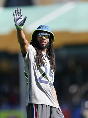Seattle Seahawks cornerback Richard Sherman waves to fans during the NFC practice for the Pro Bowl on Wednesday in Lake Buena Vista, Fla.