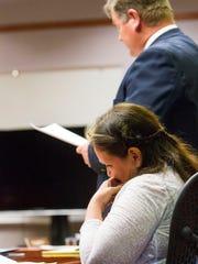 Vickie Sorensen listens as defense attorney Matthew