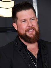 Zach Williams arrives at the 59th annual Grammy Awards at Staples Center.