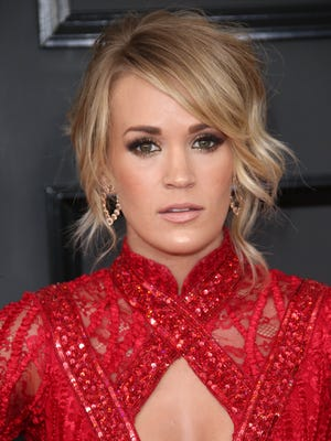 Carrie Underwood told fan Monday, Jan. 1, 2018 that she needed more than 40 stitches after a fall in November outside her Nashville area home.