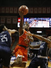 UTEP senior Dominic Artis tries to go up for a shot
