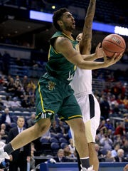 Vermont forward Anthony Lamb (3) shoots during their