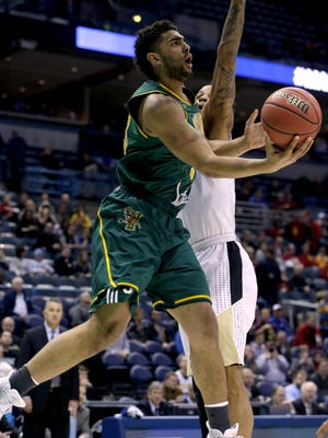 Vermont forward Anthony Lamb (3) shoots during their first round game of the NCAA Division I Men's Basketball Tournament game against Purdue Thursday, March 16, 2017 at the BMO Harris Bradley Center in Milwaukee.