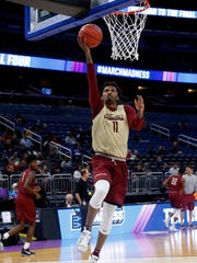 Florida State guard Braian Angola-Rodas shoots during practice prior to the first round of the NCAA Tournament at Amway Center.
