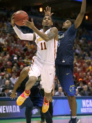 Iowa State guard Monte Morris (11) scores while being guarded by Nevada guard Lindsey Drew.