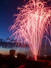 A fireworks display lights up the sky during the San