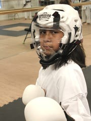 Leah McCardle is kitted out for sparring (kumite) at the Shima Dojo Karate School at the Marco Y.