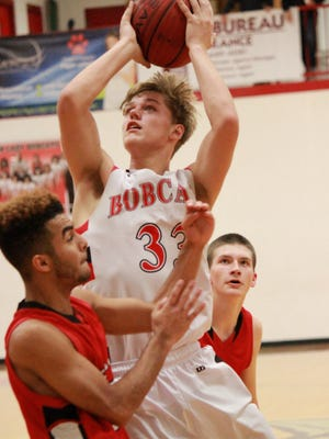 Flippin's Lance May goes up for a shot against Lead Hill on Saturday in the Billy Ply Classic.