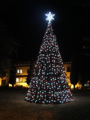 A 30-foot Christmas tree is decorated on the lawn next to Eddy County's Fifth Judicial District courthouse.