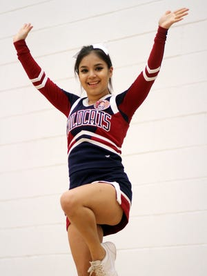 Senior Emily Jimenez is one of the varsity team's high flyers.
