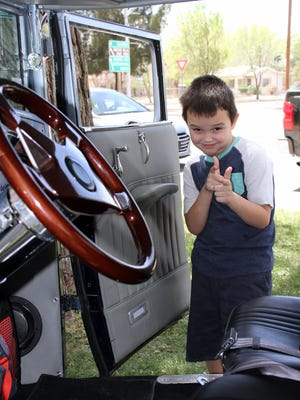 Samuel Blaze Armendariz, 7, took an interest in the interiors of this roadster at the Smok'n Oldies car show.