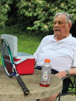 Bill Van Riper, 90, takes a break during an evening round of Tennis. He has been playing ever since he was 8-years-old.