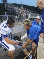 Dr. Rob Kennedy, right, has been working with Fort Defiance High School athletes for the past decade, but he recently took a job as JMU's team physician.