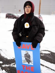 """Darlene DeSantis brought a """"Save the Eagles,"""" sign to view  """"Save the Eagles Day,"""" sponsored by the Bergen County Audubon Society on Bell Dr. in Ridgefield. Attendee viewed  Bald Eagles Al and Alice in their nest across Overpeck Creek in Ridgefield Park on Sunday, January 8, 2017."""
