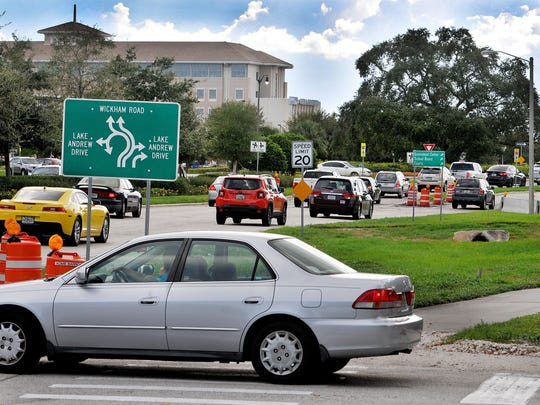 Motorists make their way through the roundabout on Wickham in Viera during rush hour.