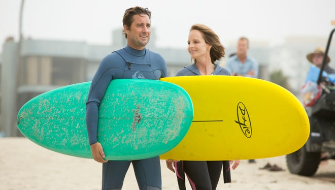 "Ian (Luke Wilson) teaches Jackie (Helen Hunt) how to surf and how to loosen up in ""Ride."""