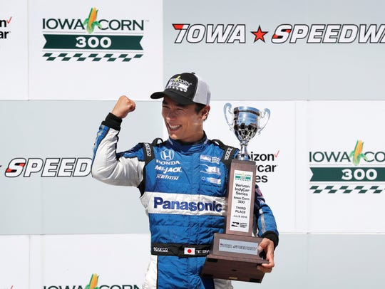 Takuma Sato celebrates after finishing in third place