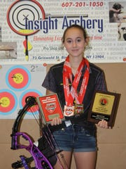 Marissa Harding, 13, of Vestal, has won several indoor and outdoor state championships with the compound bow.