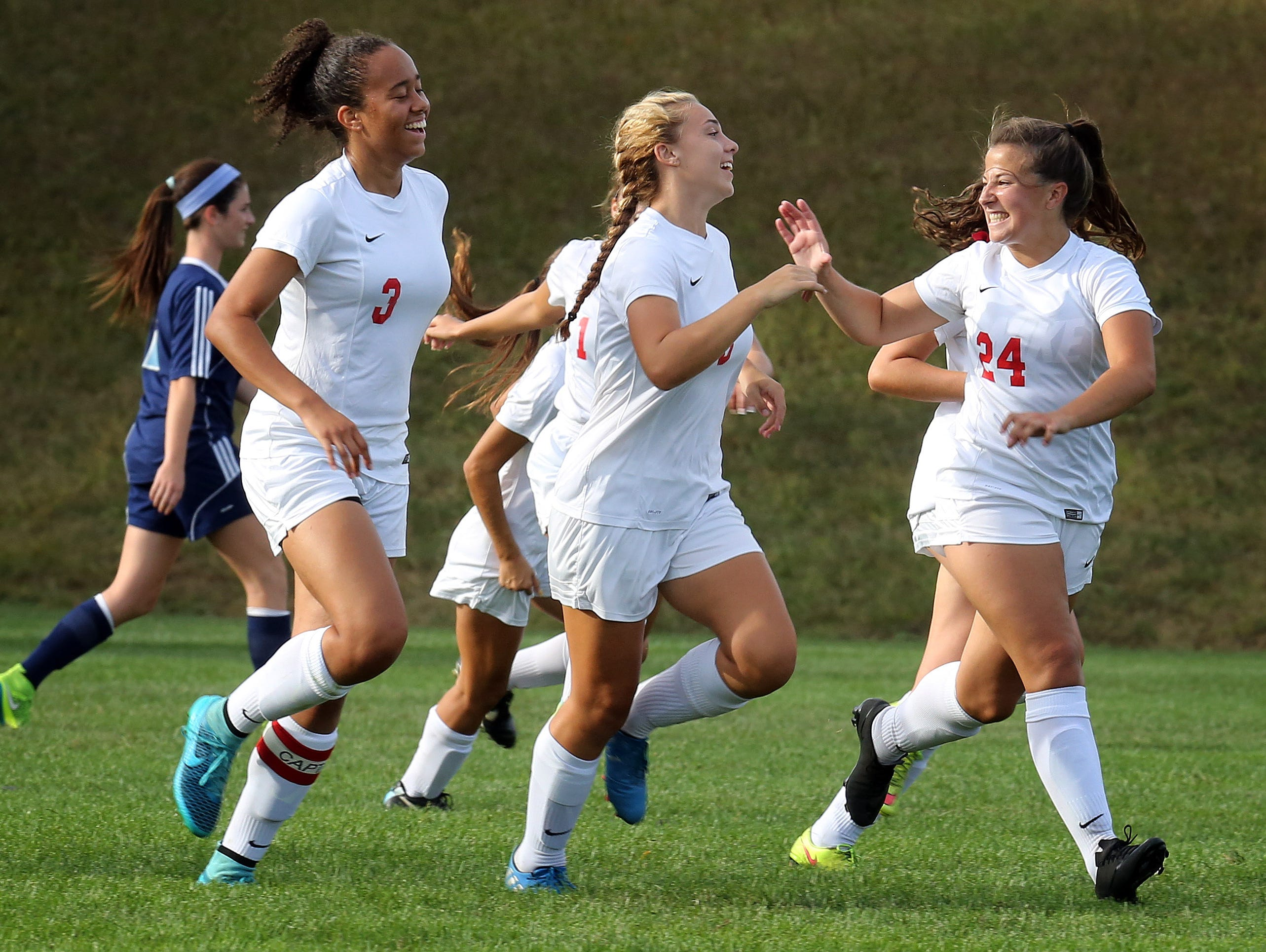 North Rockland's Ava Desposito (18) celebrates her goal with her teammates during girls soccer game against Suffern at North Rockland High School in Theills on Sept. 21, 2016.