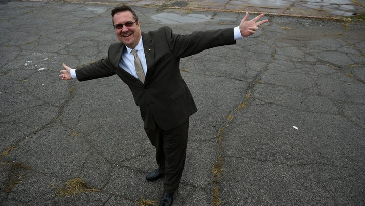Entrepreneur Mark Cleveland stands where his new hotel will be built at Ash and Lafayette streets in Nashville. The hotel won't offer on-site parking, instead relying on Uber, Lyft and and self-driving cars.