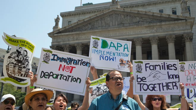 Demonstrators protest against a Supreme Court decision on immigration in New York on Friday.