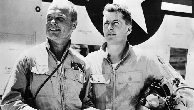 In July 16, 1957, Maj. John Glenn, left, of the Marines, and Lt. Cmdr. Charles Demmler of the Navy, are slated to fly a pair of F8FU Crusader jet airplanes from Long Beach, California to New York. Later that day, Glenn set a new transcontinental speed record: 725.55 mph.