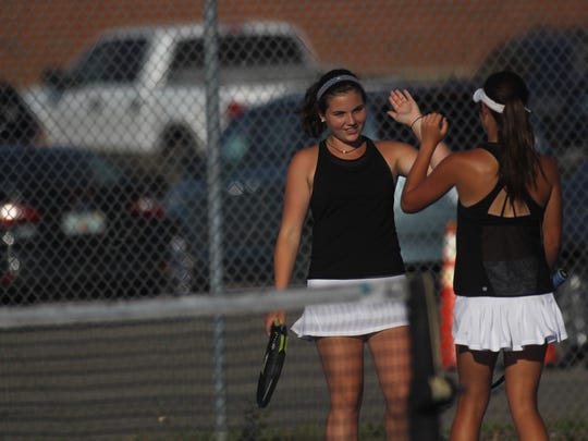 Chiles' Anna Vinson celebrates with doubles partner Gracie Wilson after winning a second-set point.