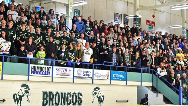 Mourners attended a vigil to honor victims of Friday night's Humboldt Broncos bus crash.