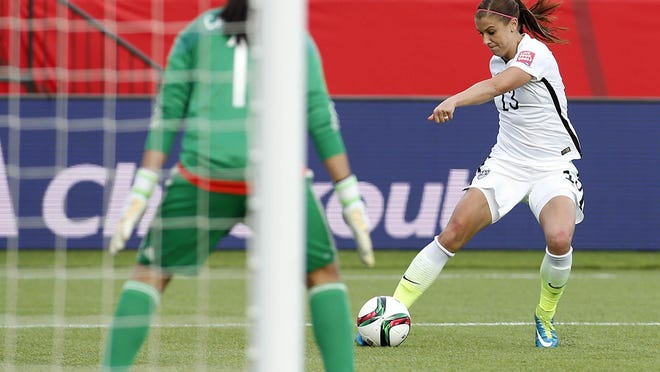 United States forward Alex Morgan scores a goal during the second half against the Colombia in the round of sixteen in the FIFA 2015 women's World Cup.